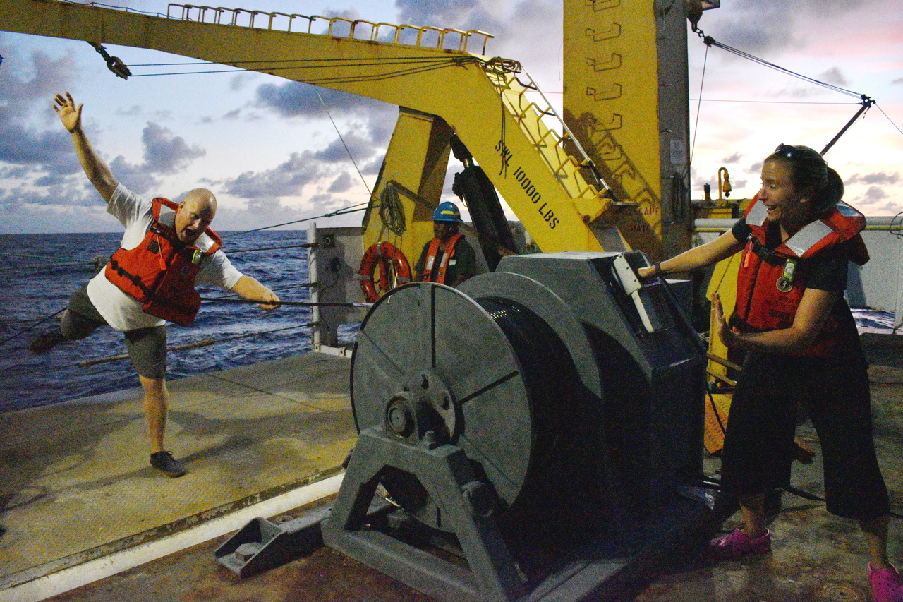 Deploying the towed array system off the stern (back) of the boat for nighttime eavesdropping.