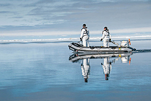 Searching for ice-associated seals.  Photo credit: David Withrow (NOAA Fisheries).