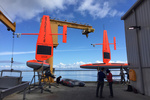 Technicians prepare the first two Saildrones for launch