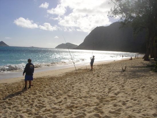 Anglers fishing on Waimānalo beach.